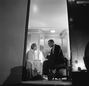 """Debbie Reynolds talking with Fred Astaire in his dressing room during a break in filming """"The Pleasure of His Company"""" 1960 © 1986 Sid Avery - Image 0071_0011"""