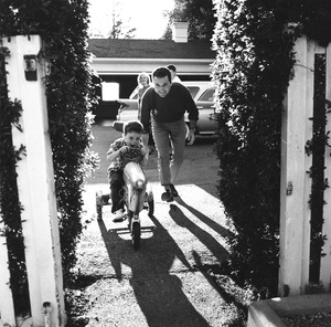 Jackie Cooper playing with his son Russell at their home in Brentwood, CA 1961 © 1978 Sid Avery - Image 0078_0047