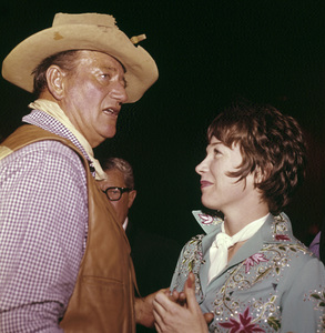 Shirley MacLaine and John Wayne at a Share party1965© 1978 David Sutton - Image 0086_0386