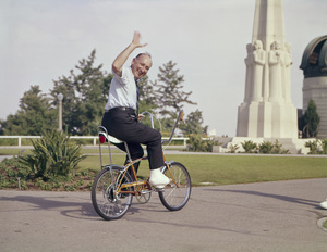 Photographer Sid Avery on a Schwinn bicycle at the Griffith Park Observatorycirca 1966 © 1978 Sid Avery - Image 0090_1075