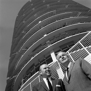 Architect Welton Becket and Glen Wallichs standing in front of the Capitol Records Tower 1958 © 1978 Sid Avery - Image 0106_0002