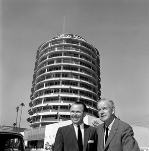 Architect Welton Becket and Glen Wallichs standing in front of the Capitol Records Tower 1958 © 1978 Sid Avery - Image 0106_0003