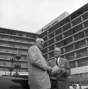 Architect Welton Becket and Conrad Hilton standing in front of the Beverly Hilton Hotel 1958 © 1978 Sid Avery - Image 0106_0004