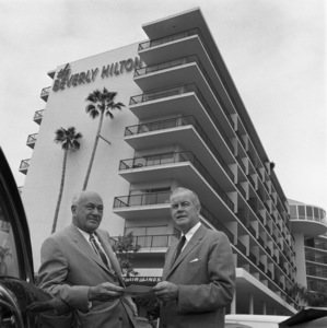 Architect Welton Becket and Conrad Hilton standing in front of the Beverly Hilton Hotel 1958 © 1978 Sid Avery - Image 0106_0005