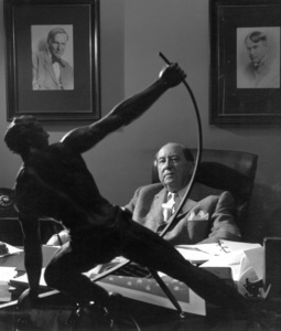 Jerry Giesler Defense Attorney for the stars. At his desk flanked by his two idols.