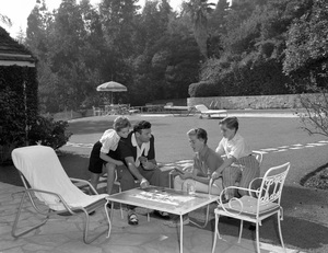 Frankie Laine playing cards with his wife Nan Grey and her two children1954 © 1978 Sid Avery - Image 0191_0042