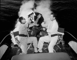 Bo Roos on his boat with Art Lashelle to the leftand William Lundigan to the right, 1951. © 1978 Sid Avery - Image 0225_0002