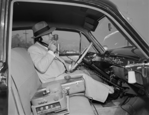 Bo Roos on the first car phone in his 1951 Cadillac1951© 1978 Sid Avery - Image 0225_0004