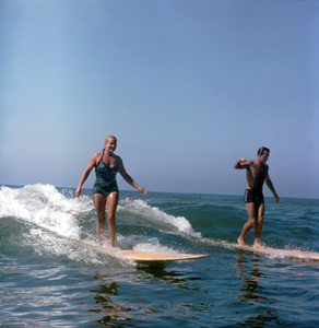 Surfers Young Woman and Man Surfing 1957 © 1978 Sid Avery - Image 0250_0051