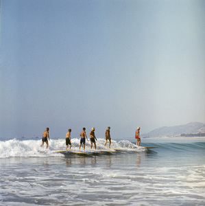 Surfers coming in on a wave at Rincon Point in Carpinteria, California1957© 1978 Sid Avery - Image 0250_0054