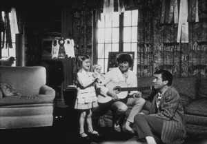 Efrem Zimbalist, Jr. with his wife and daughter, Stephanie, at home in Encino, CA, January 15, 1961. © 1978 Sid Avery MPTV - Image 0286_0076