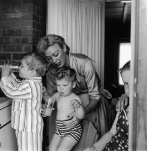 Eve Arden with her children, Duncan, Douglas and Connie in their kitchen1956 © 1978 Sid Avery - Image 0287_0093