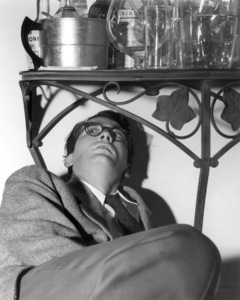 Gregory Pecklooking up through glass table, 1947Copyright John Swope Trust / MPTV - Image 0288_0209