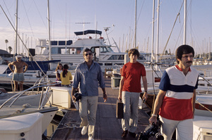 Jerry Lewis about to board his 60 foot yacht Princess Two with his son1972 © 1978 Gunther - Image 0292_0561