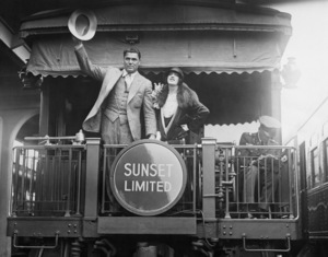 Jack Dempsey and Estelle Taylor at S.P. Station in Los Angeles as they head off to New York for his comeback fight06-17-1927** Sheryl Deauville Collection - Image 0296_0002