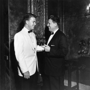 "George Stevens with son George Stevens Jr. at the premiere of ""Shane"" held at Grauman"