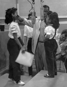 Nat King Cole with wife Maria, daughters Carole and Natalie during a Capitol recording session circa 1955 © 1978 Lou Jacobs Jr. - Image 0321_0196