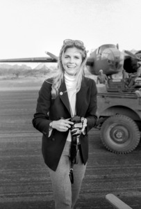 """Candice Bergen and camera while visiting the """"Catch-22"""" location in Guaymas, Mexico 1969 © 1978 Bob Willoughby - Image 0324_0205"""