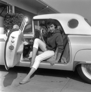 Annette Funicelloin her 1957 Ford Thunderbird at  home in Los AngelesCirca 1957Photo by Joe Shere - Image 0330_0127