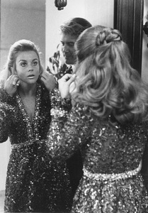 Ann-Margret and husband Roger Smithgetting ready to go out in Beverly Hills, CAwearing an Oscar De La Renta original dress1970 - Image 0332_0171