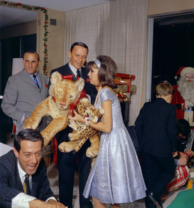 Frank Sinatra gives Christmas gifts to Nancy at homecirca 1966© 1978 Ted Allan - Image 0337_0783