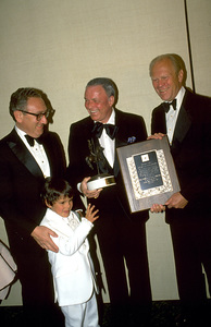 """Frank Sinatra with Gerald Ford and H. Kissingerreceiving """"Man Of The Year"""" Awards. © 1979 Gunther - Image 0337_1362"""