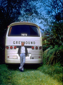 Frank Sinatra leaning on a bus during the L.A. rehearsal for his Ceaser