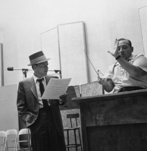 Frank Sinatra with conductor Felix Slatkin at a Capitol Records recording session, c. 1954 © 1978 Sid Avery - Image 0337_2124