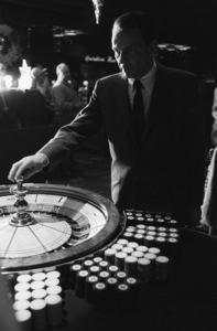 Frank Sinatra spins the roulette wheel at the Sands Hotel in Las Vegas1960 © 1978 Bob Willoughby - Image 0337_2633