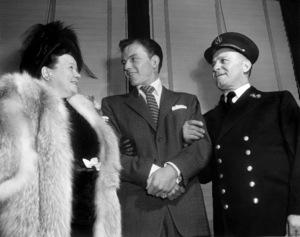 Frank Sinatra with his parents, Natalina Garaventa and Antonino Martino Sinatra, in December of 1947, New York City** I.V. - Image 0337_2737