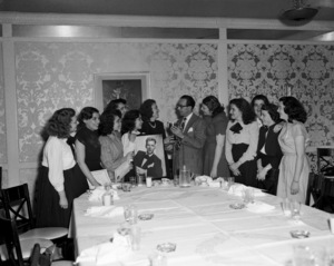 The officers of the original Frank Sinatra Fan Clubs Guild standing with George Evans (Sinatra
