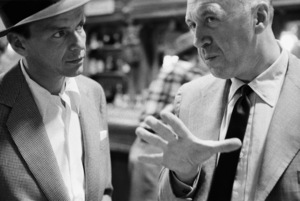 """Director Otto Preminger shows Frank Sinatra around the set of """"The Man with the Golden Arm"""" on the RKO Studios lot1955© 1978 Bob Willoughby - Image 0337_3007"""