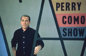 """Perry Como rehearsing for """"The Perry Como Show""""on NBC / Sept. 1958. © 1978 George E. Joseph - Image 0505_0008"""