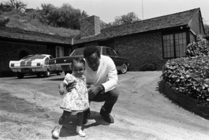 Bill Cosby at home with his daughter Erika (1966 Ford Shelby GT350 Mustang in background)1966 © 1978 Gunther - Image 0506_0576