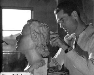 Henry FondaSculpting head of his wife, 1939.Copyright John Swope Trust / MPTV - Image 0518_0838