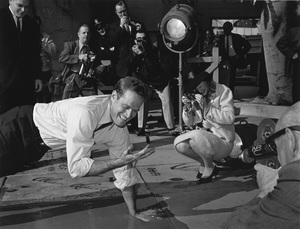 Charlton Heston places his handprints in cement outside Grauman