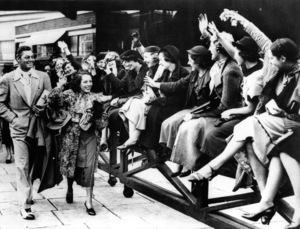Johnny Weissmuller and Lupe Velez arriving at Paddington Station in London as admirers cheer10-12-1934 - Image 0579_0135