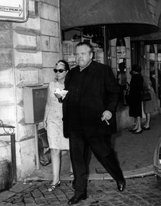Orson Welles and his secretary Miss M. Coppiello go for a stroll on Rome
