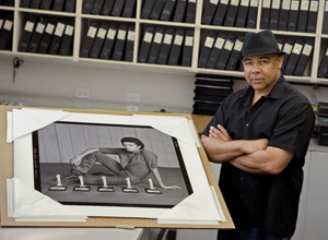 Photographer Bobby Holland posing with one of his most iconic photos of Michael Jackson2017© 2017 Andrew Howick - Image 0628_0203a