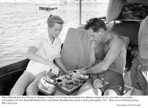 """When Deborah Kerr was filming on """"Bonjour tristesse"""" in St. Tropez, her husband Anthony Bartley brought her two girls down for a holiday, and together with their friend William Holden and his wife Brenda Marshall, they rented a small yacht together.  Here you see Deborah pouring Bill a cup of tea1957 © 1978 Bob Willoughby - Image 0632_0140"""