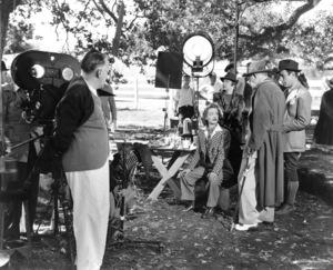 "Bette Davis, Humphrey Bogart, with director Edmund Goulding, c. 1938. Behind the scenes of ""Dark Victory.""Photo by Bert Six - Image 0701_0036"