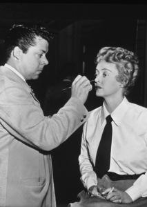 Bette Davis with makeup man, c. 1930