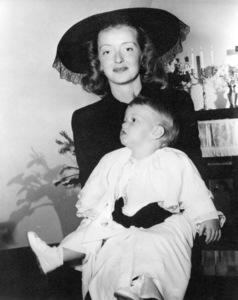 Bette Davis with daughter Barbara Davis Sherry, who is being Christened at St. Clement