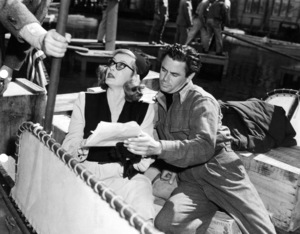 """Bette Davis, Glenn Ford and the hand of director Curtis Bernhardt on the left. Behind the scenes of """"A Stolen Life,"""" 1946. - Image 0701_1297"""
