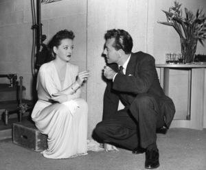 "Bette Davis, Paul Henreidon the set of ""Deception,"" 1946.Photo by Frank Bjerring - Image 0701_1306"