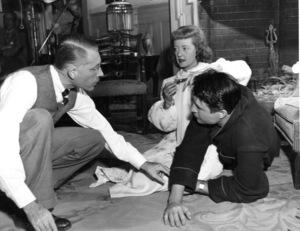 "Bette Davis, Jim Davis, Dir. Bretaigne WindustBehind the scenes of ""Winter Meeting,"" 1948.Photo by Morgan - Image 0701_1345"