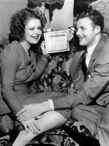 Clara Bow with husband Rex Bell holding their marriage certificate, 1931 **I.V. - Image 0704_0394
