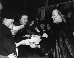 Carole Lombard handing out autographed defense bond pledges in Indianapolis, IndianaJanuary 1942 - Image 0705_2272