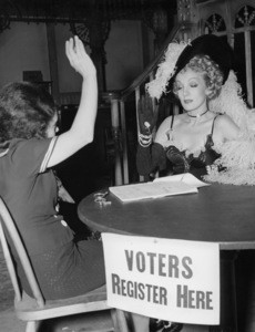 """Marlene Dietrich registers to voteon the set of """"Destry Rides Again""""Universal 1939**I.V. - Image 0709_1956"""