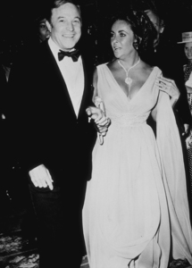 """Elizabeth Taylor and Gene Kelly attend the opening of """"That"""